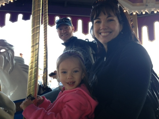 carousel riding while waiting for Fast Pass