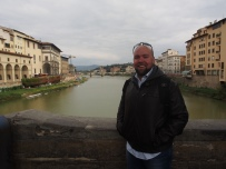on the Ponte Vecchio looking at the Arno river