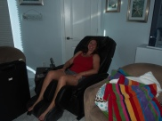my sis taking advantage of the massage chair