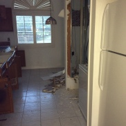 This random wall in the kitchen had all our electrical wiring, so we couldn't get rid of it. Yay!