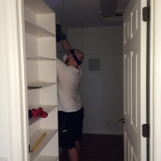 Taking out more useless wire shelving system from our master closet.