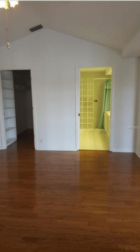 the view of the closet and bathroom in the master